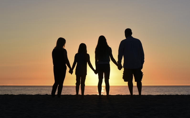 Family in a sunset.